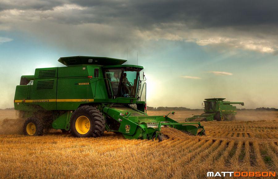 Two John Deere Combines Harvesting A Field Of Wheat Mattdobsonphotography