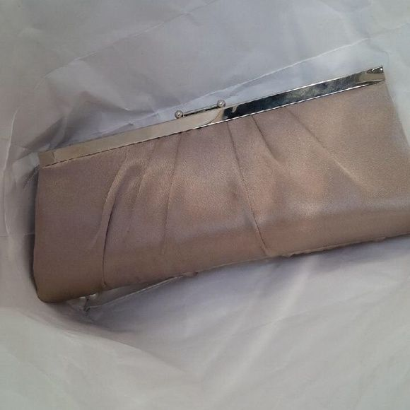 Clutch Bronze colored clutch. Worn twice. In very good condition. Smoke free and pet free home Bags Clutches & Wristlets