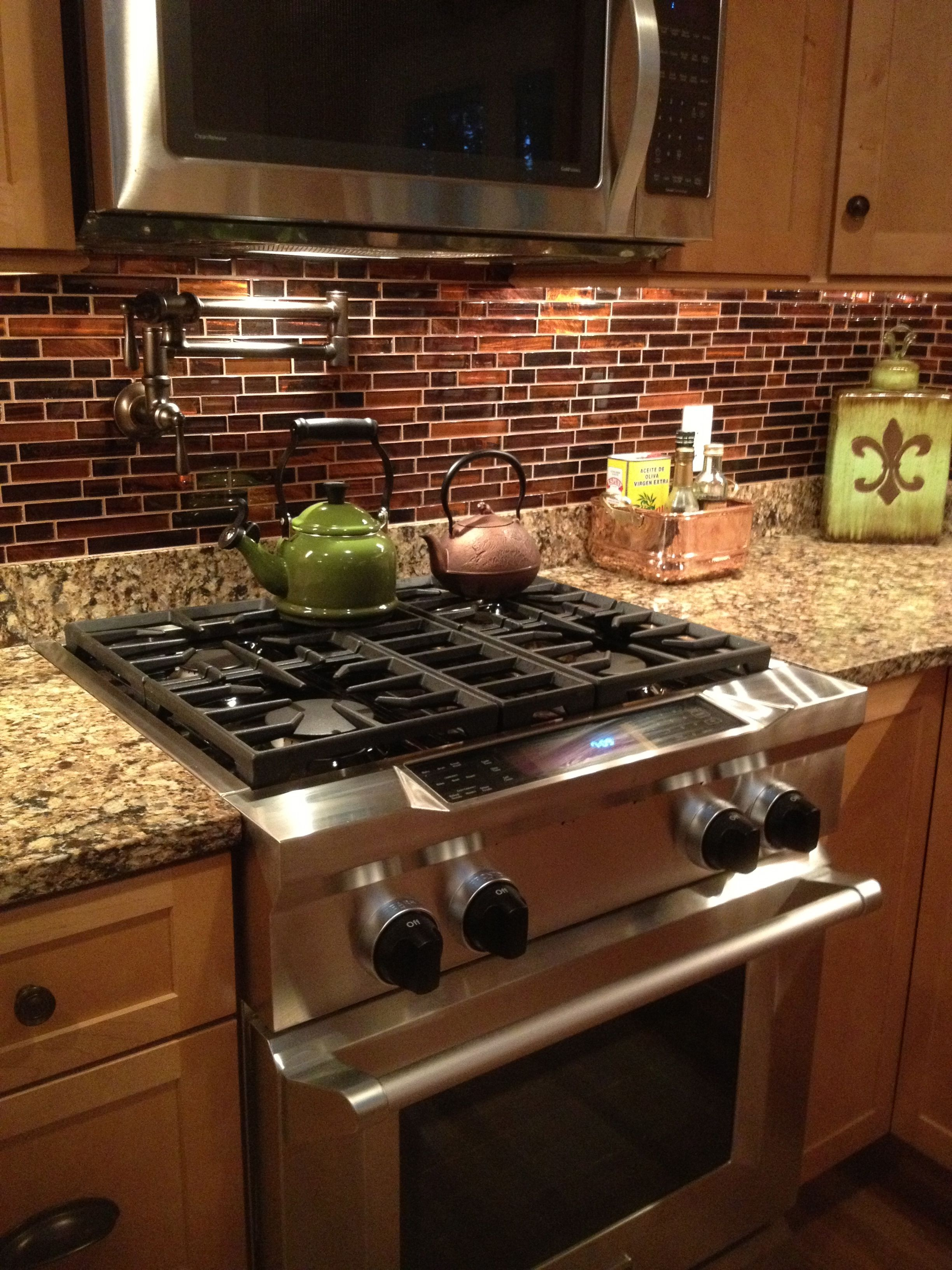 - Copper Backsplash, Cambria Quartz, Maple Cabinetry, Bronze Pot