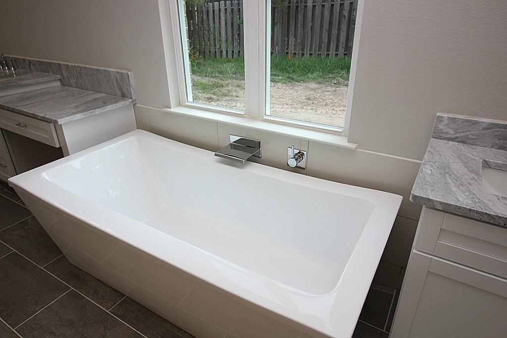 1126 Looking Glass Montgomery, TX Photo 6 Foot Long Free Standing Tub.  Features Waterfall Faucet And Very Relaxing Ideas