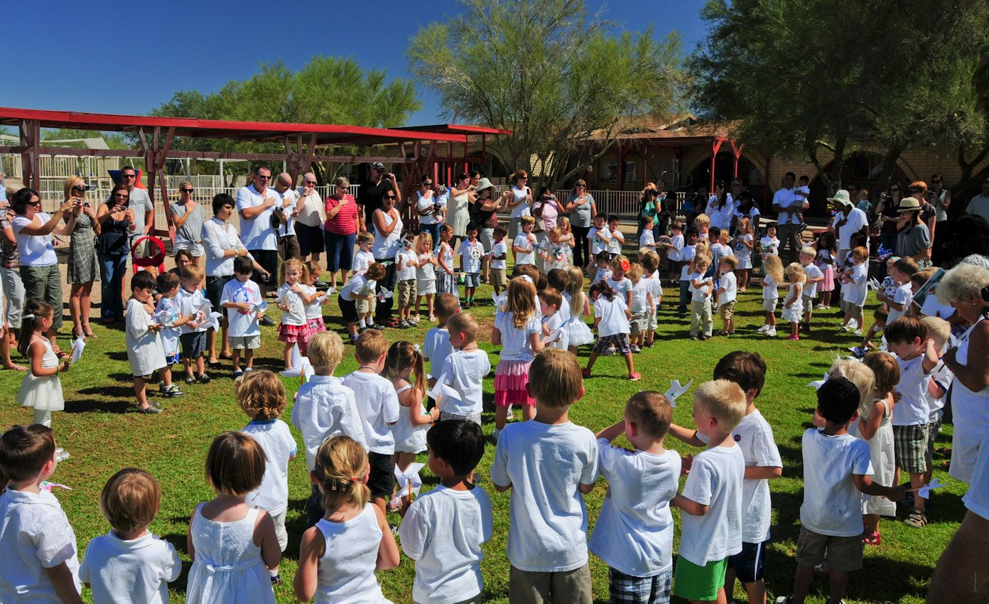 The children of Cave Creek Montessori gather together to celebrate international peace day on our beautiful, custom designed playground.