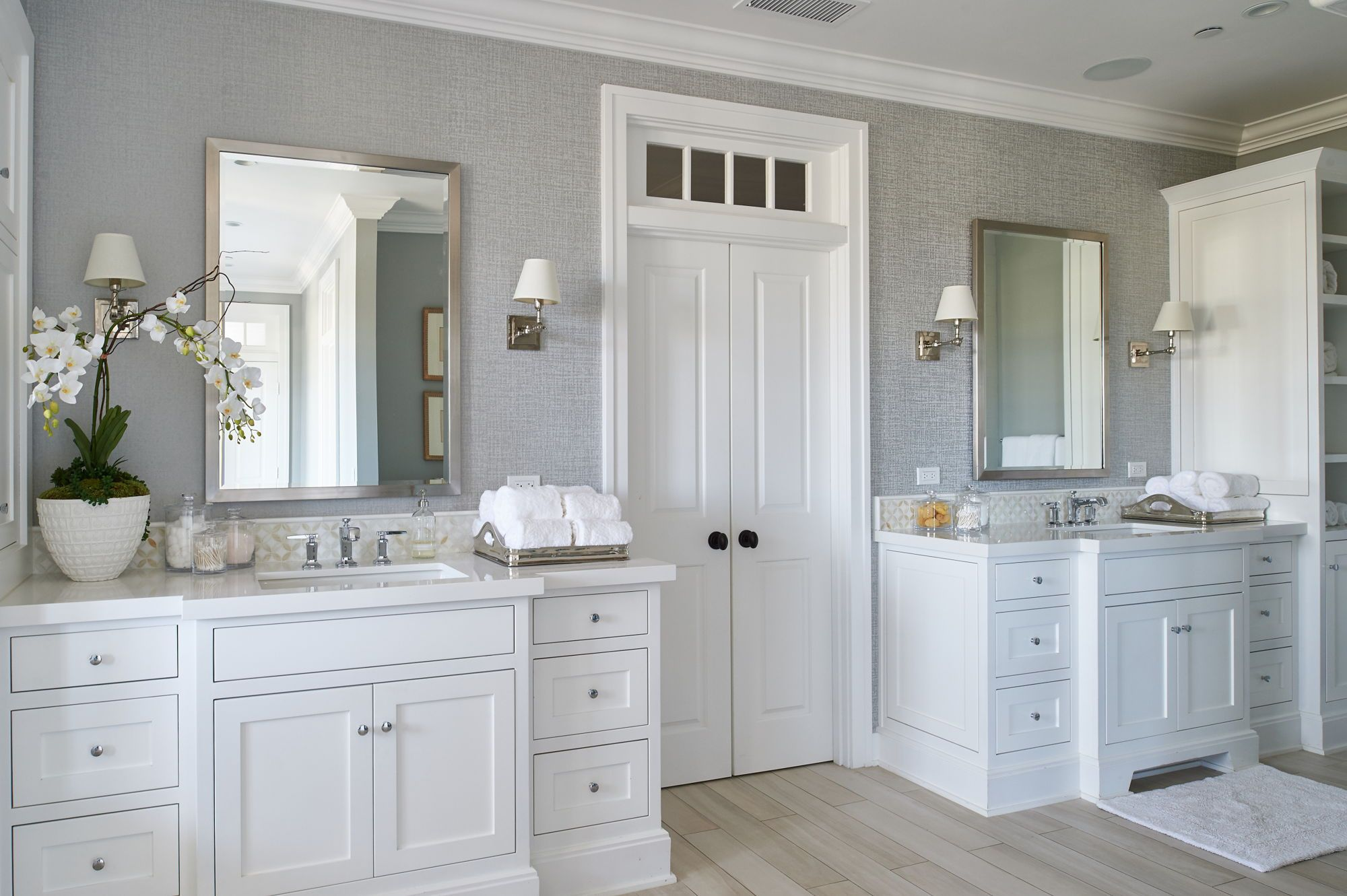 His And Her Vanities In A Large Master Bathroom White Vanities With Chrome Fixtures A Master Bathroom Design Farmhouse Master Bathroom Bathroom Remodel Master