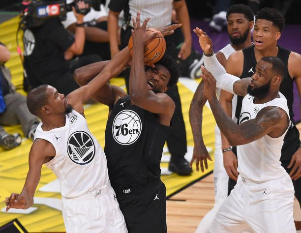 Kevin Durant and LeBron James of Team LeBron guard Joel Embiid of Team  Stephen in the fourth quarter of the NBA AllStar Game 2018 at Staples  Center. 01f119f48