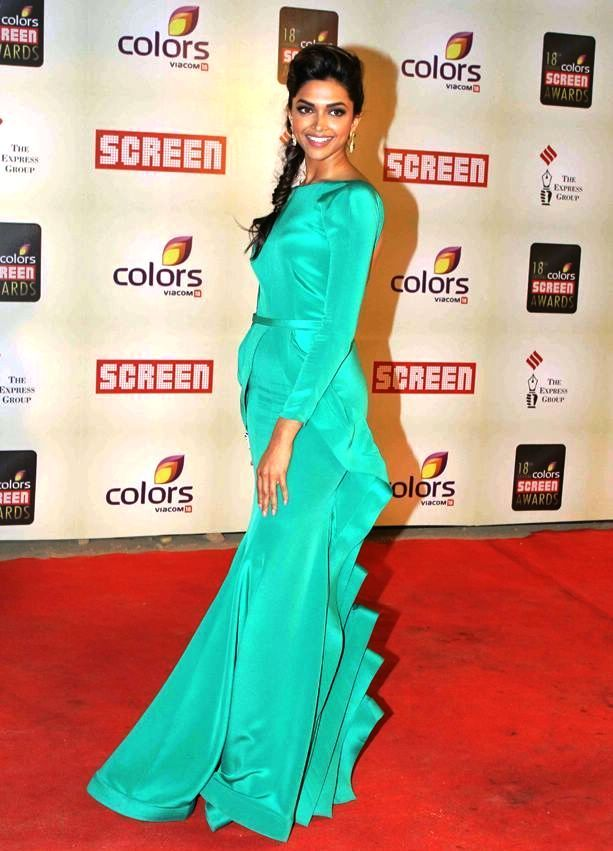 Deepika Padukone, in Green backless gown with RK Tattoo at