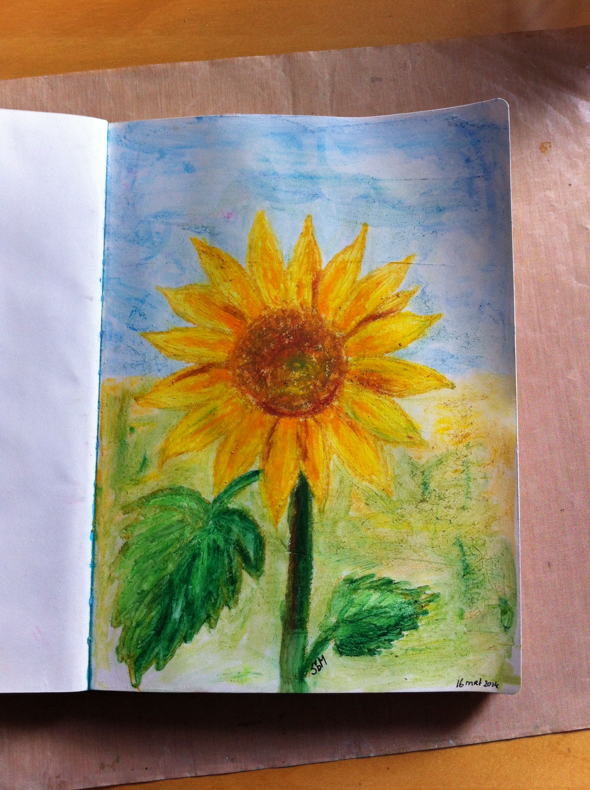 Sunflower made with oil pastels.