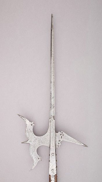 Halberd | Italian, Venice | The Met Date:ca. 1520 Geography:Venice Culture:Italian, Venice Medium:Steel, wood, textile Dimensions:L. 8 ft. 10 1/2 in. (270.5 cm); L. of head 24 in. (61 cm); W. 11 1/4 in. (28.6 cm); Wt. 4 lbs. 8.2 oz. (2046.8 g) Classification:Shafted Weapons Credit Line:John Stoneacre Ellis Collection, Gift of Mrs. Ellis and Augustus Van Horne Ellis, 1896 Accession Number:96.5.18