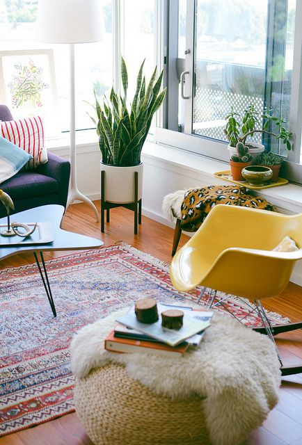Attractive Midcentury Living Room // Yellow Chair // Snake Plant In Modern Planter //  Patterned Rug // Large Windows // Lots Of Textures