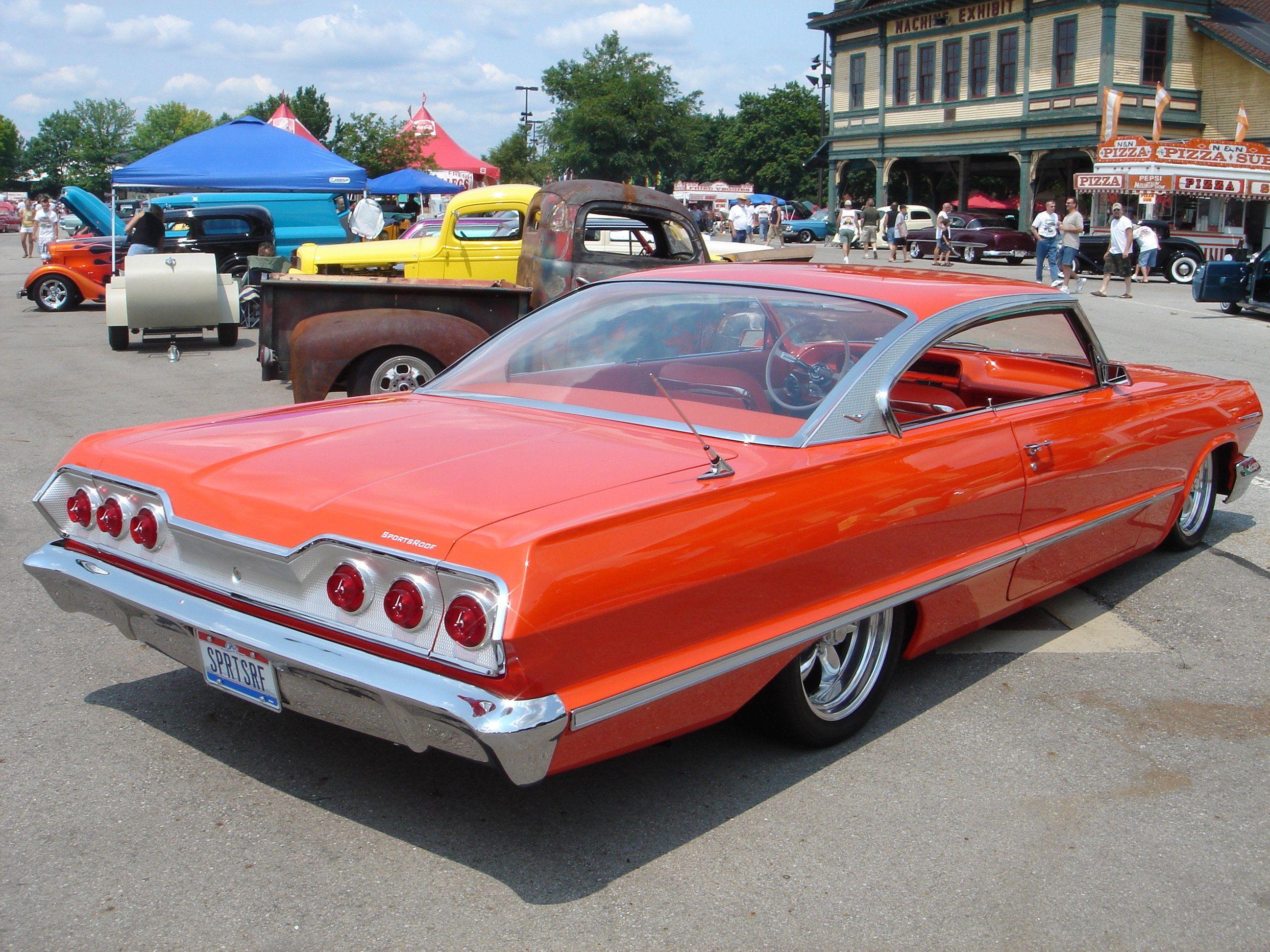 Custom Orange 1963 Impala SS with heavy modifications