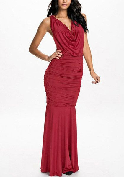 This red ruched mermaid gown features a halter cowl neck design in front, open back detailing with two lines of chain with rhinestones, and a pleated bottom in fish tail style. | Lookbook Store