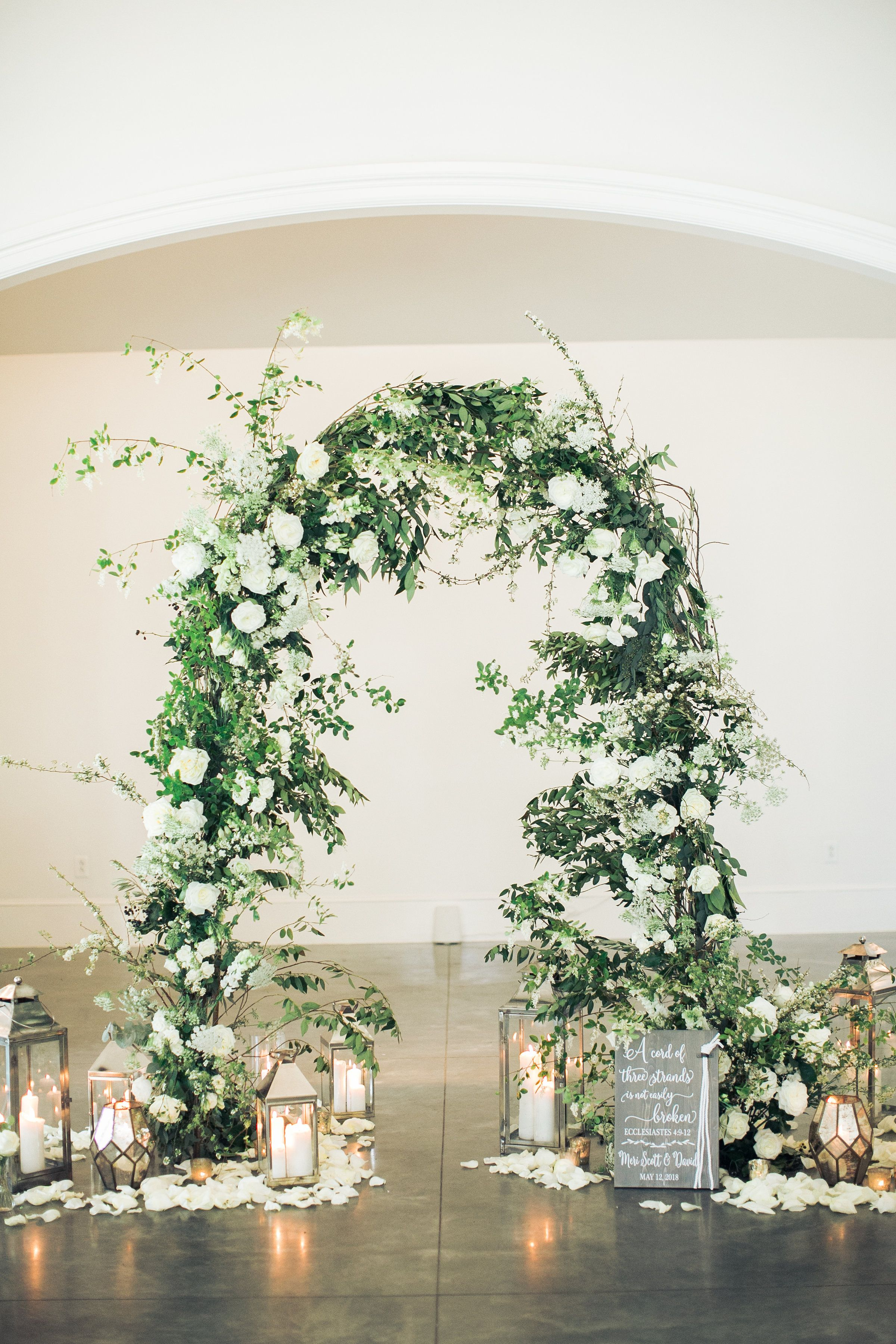 Ceremony Arch With Branches And White Flowers Surrounded By Lanterns Candles And Vintage Wedding Arches Wedding Ceremony Flowers Wedding Ceremony Decorations