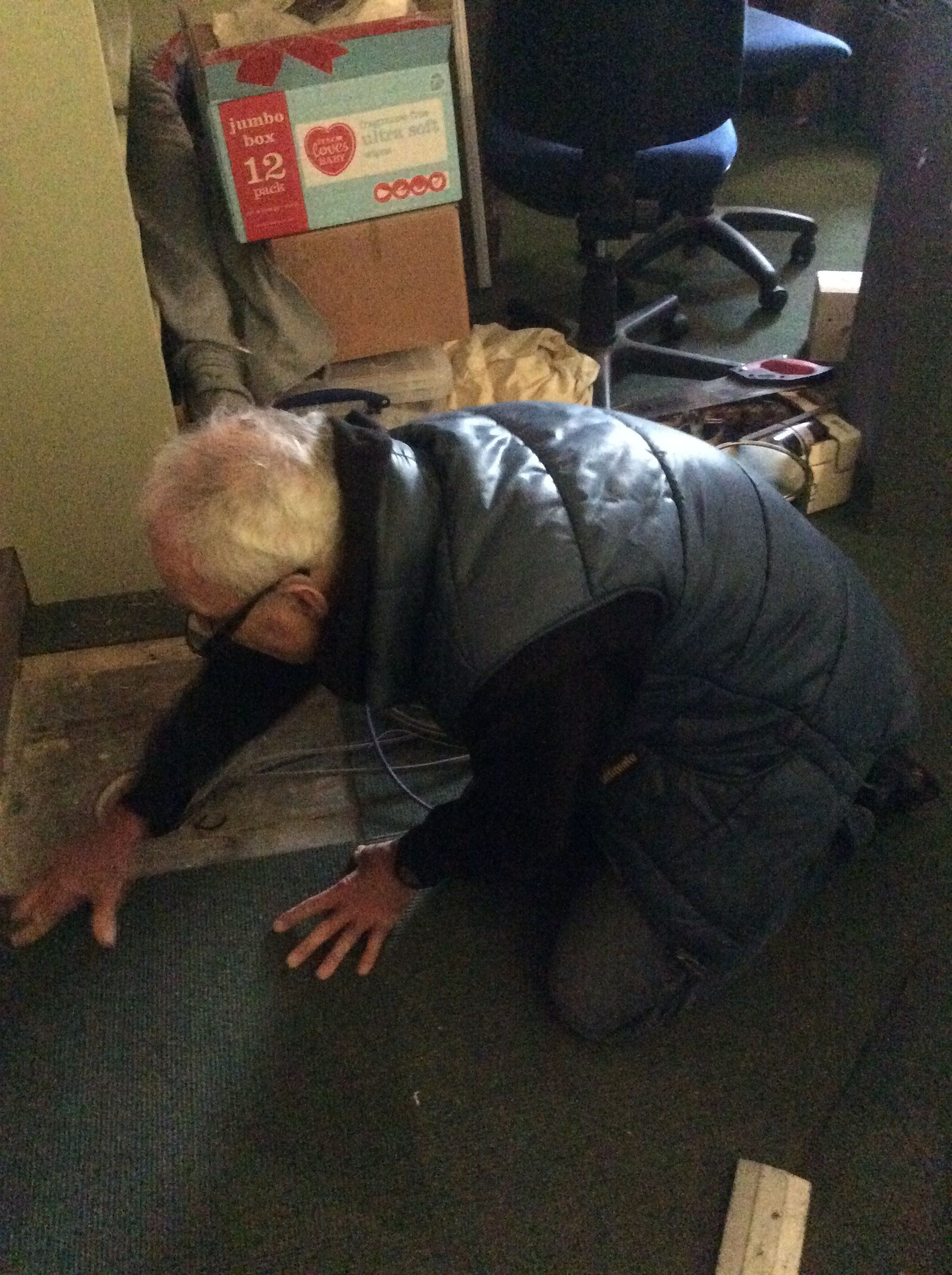 Ron fixing floor tiles at reception