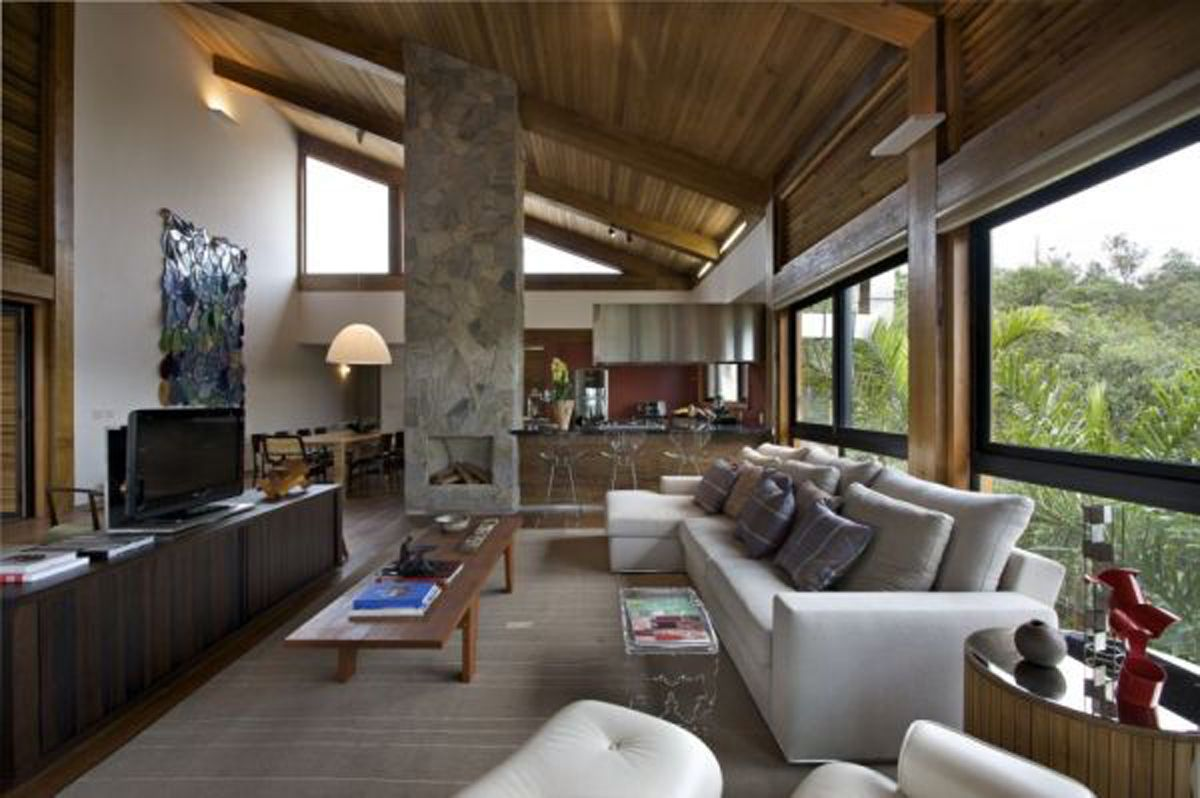 Rock and wood combination mountain house from david guerra architecture living room