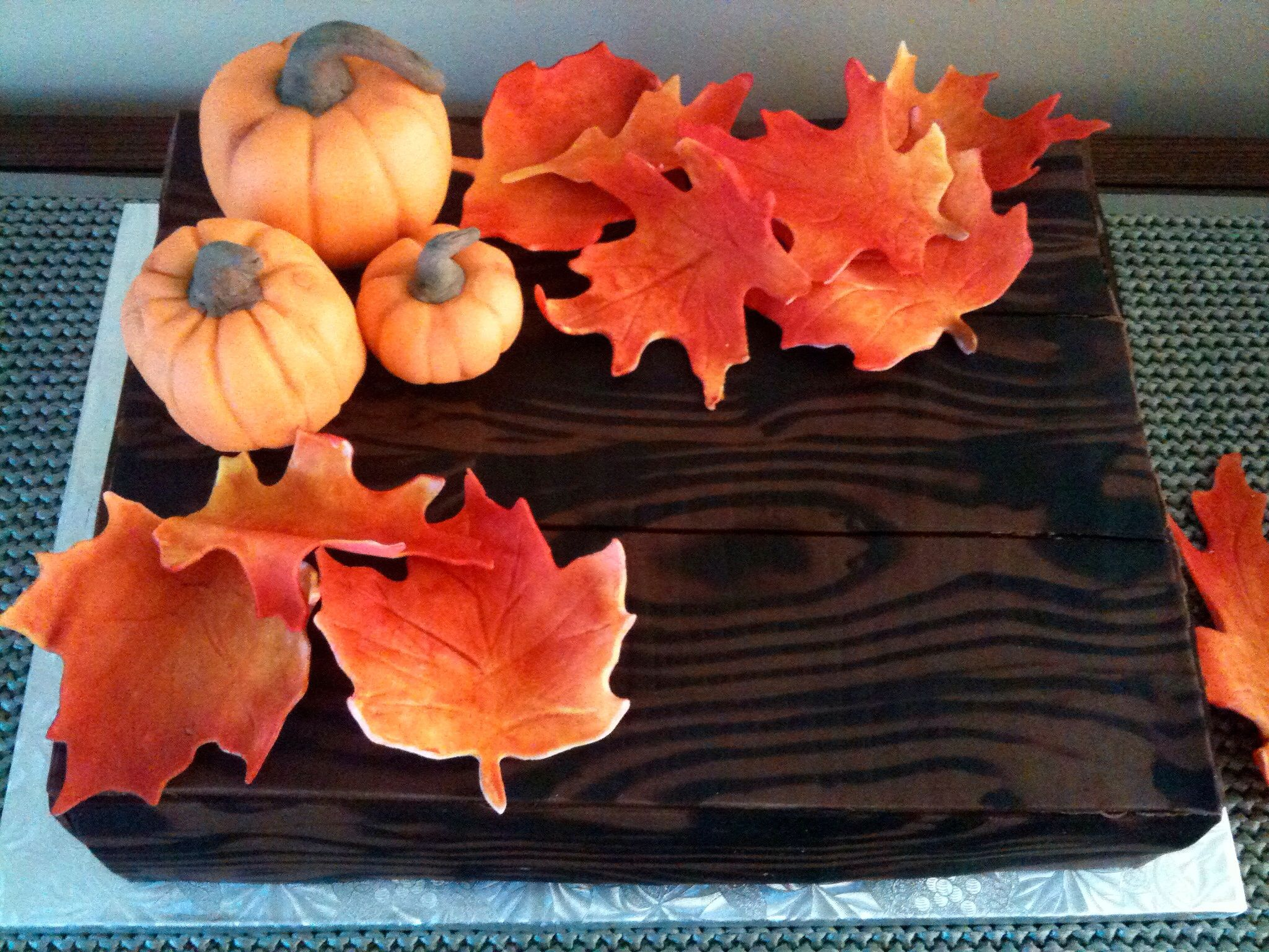 Wood cake, with fondant leaves and pumpkins.
