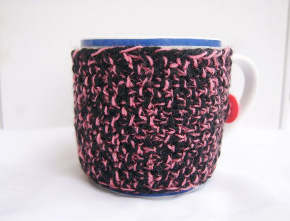 Hand knitted black with pink cup cozy with pink button
