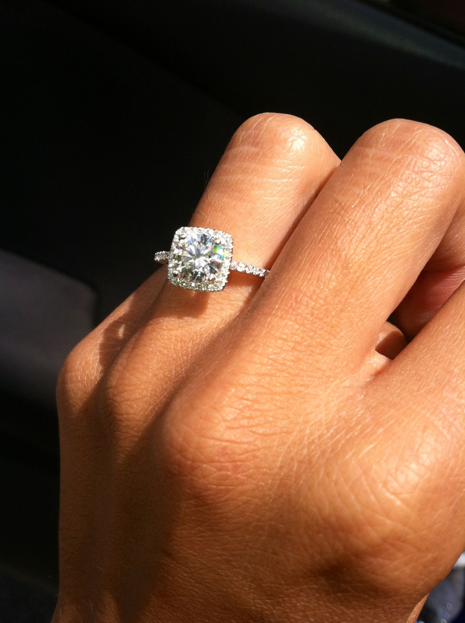 Cushion style halo engagement ring with pave diamonds and thin
