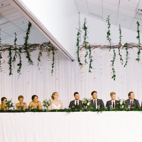 Gorgeous greens and leafy garlands filled this romantic riverside celebration. Photo via Kamp Photography.