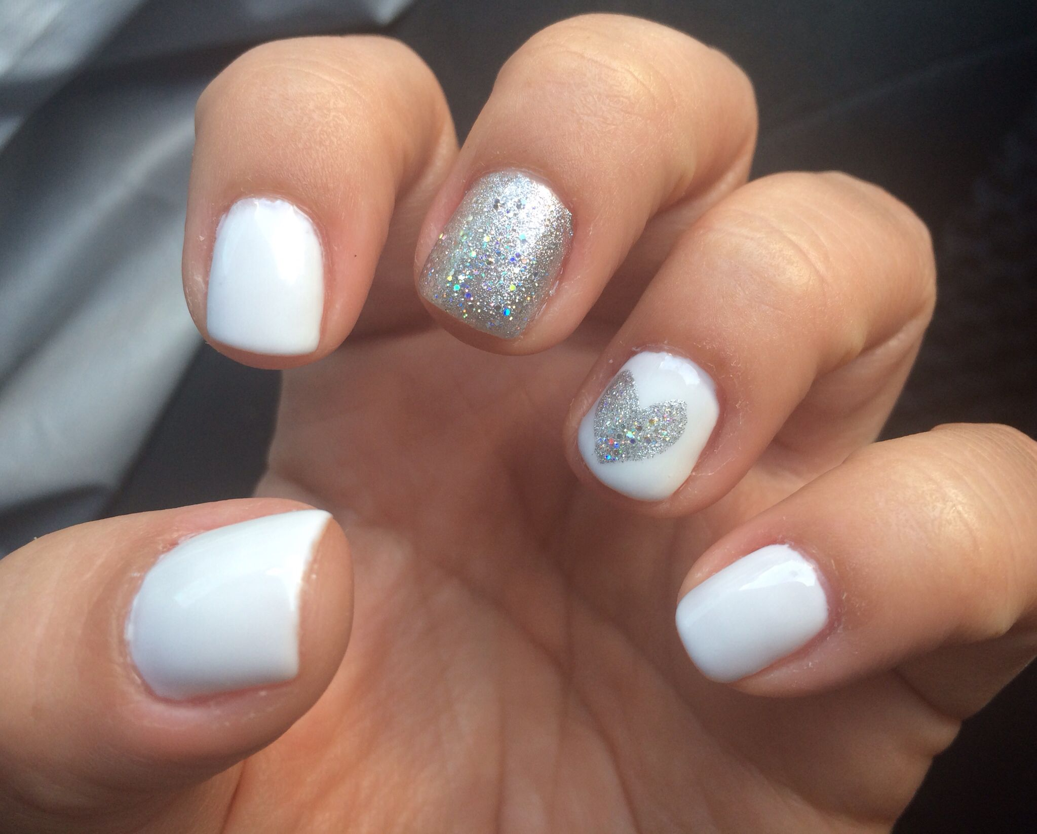 Love for the summer...white gel nails with silver heart design ...