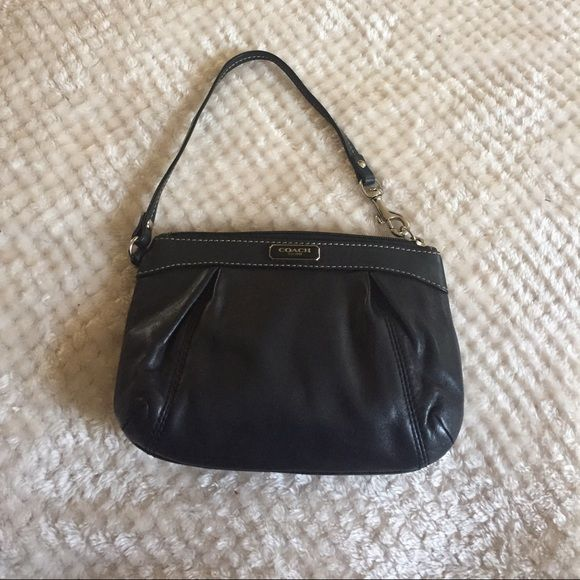 Black Coach wristlet Black leather coach wristlet gently used slight makeup stain around inner lining ( shown in picture) Coach Bags Clutches & Wristlets