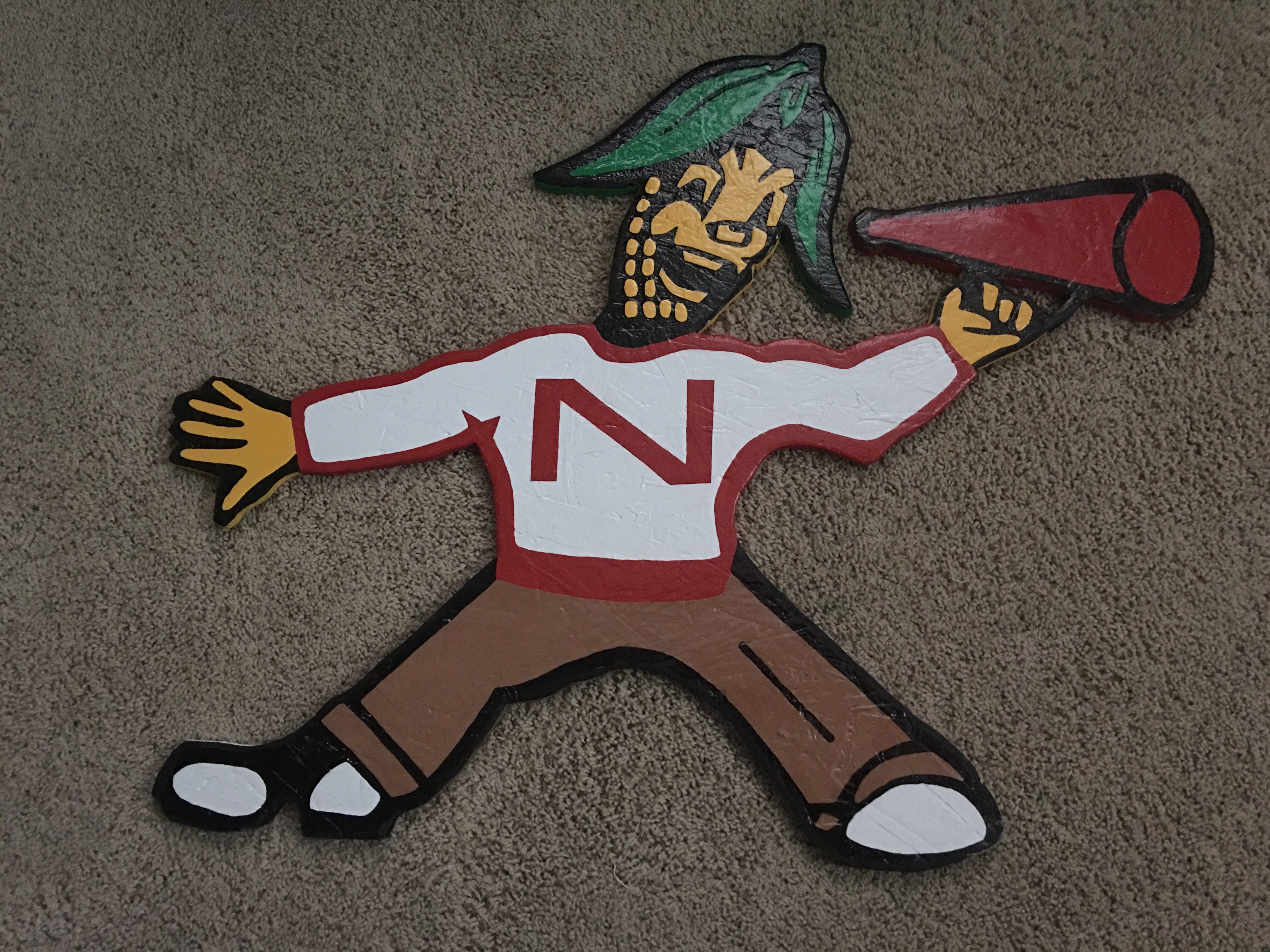 This is my rendition of Johnny Cornhusker. A mascot used by Nebraska in the 50s and 60s. Go Big Red! Huskers sign logo