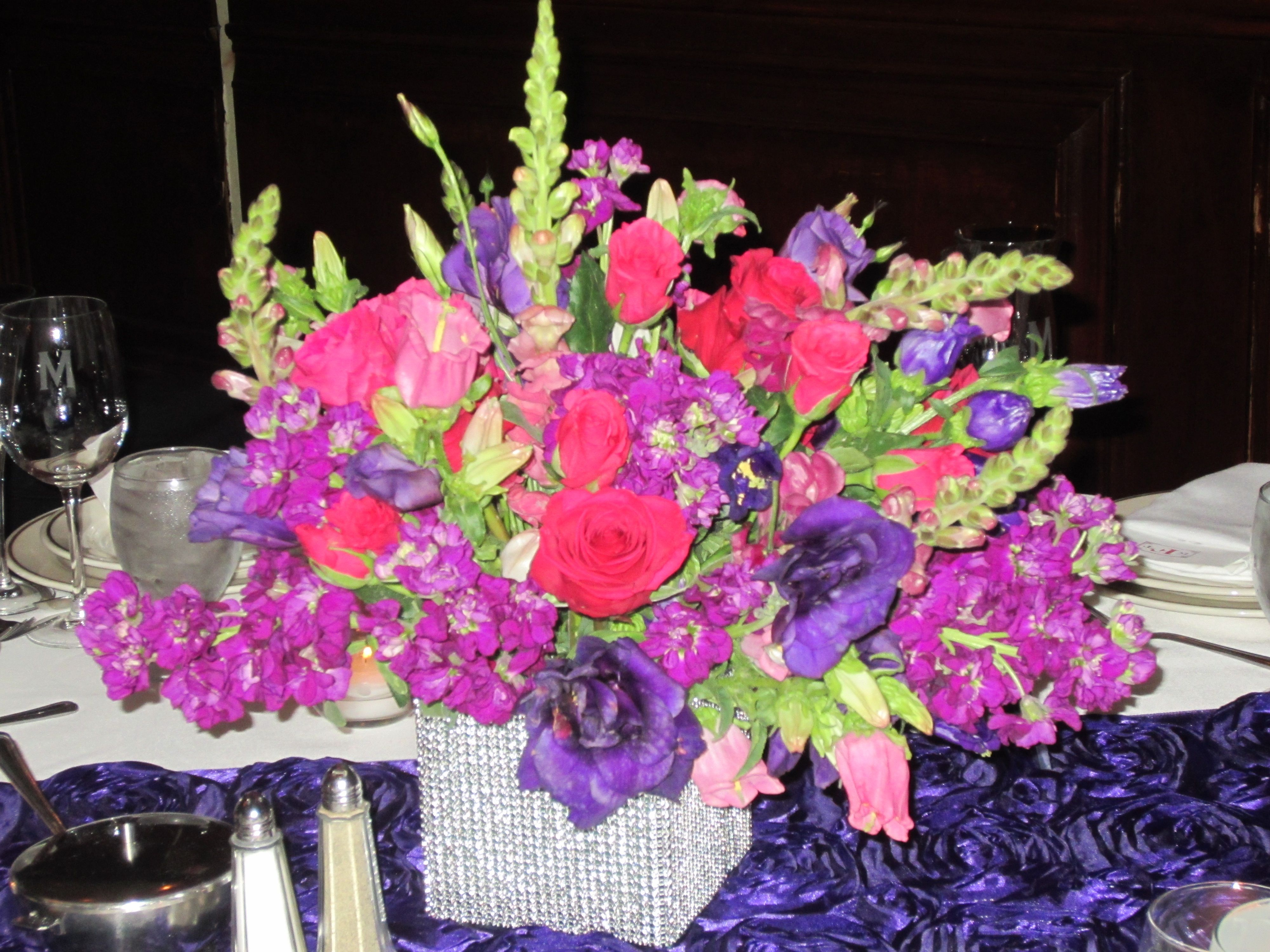 June Wedding Center Piece: Having short & tall arrangements gives a room depth & creates highs and lows for the eye.