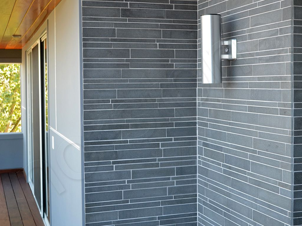 Norstone Grey Basalt IL Tiles on modern house exterior | Fireplace