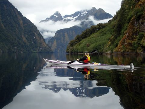 Kayaking Doubtful Sound, a fjord in Fiordland, far south west of South Island, New Zealand. Near Milford Sound.