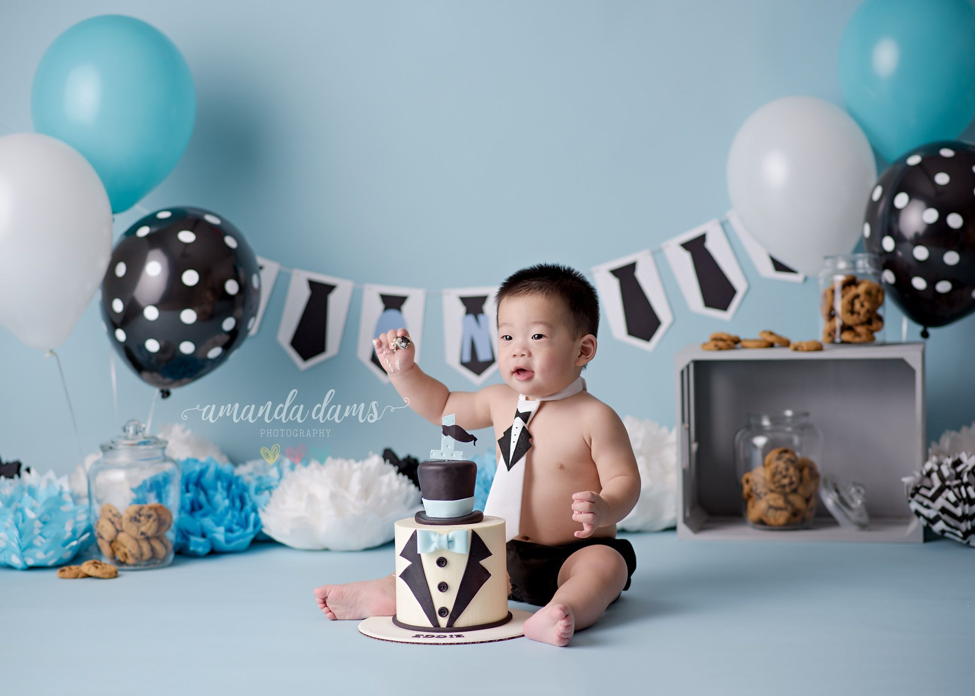 Baby boss birthday ideas Blue white and black cake smash
