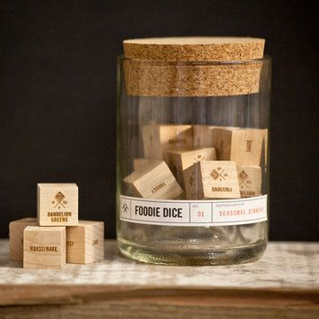 """What should I make for dinner?"""" with a roll of the dice. Foodie Dice comes with five primary dice (protein, cooking method, grain/carb, herb, bonus ingredient) and four seasonal veggie sides, for 186,000 possible meals."""