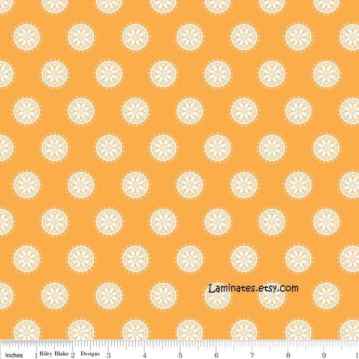 LAMINATED cotton fabric (aka oilcloth) by the yard - Madhuri orange circles (aka oilcloth, coated vinyl yardage) by Laminates on Etsy https://www.etsy.com/listing/155181096/laminated-cotton-fabric-aka-oilcloth-by
