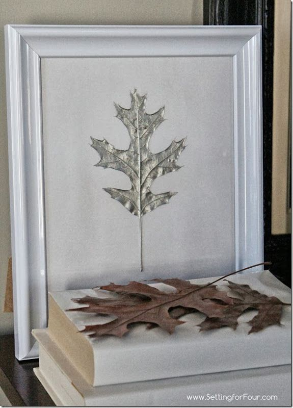 DIY Silver Painted Oak Leaf Art from Setting for Four. I am going to do this but change the background and paint the leaves in fall colors