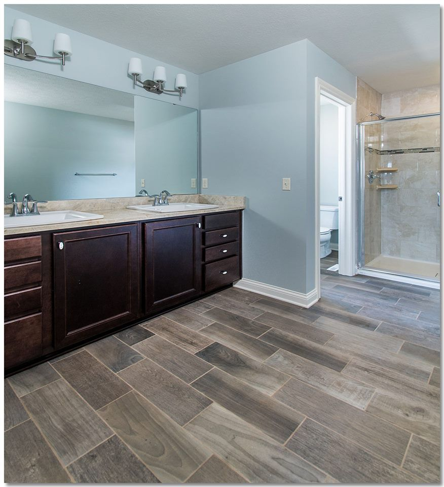 Master bathroom with custom tiled shower and wood look gray tiles ...