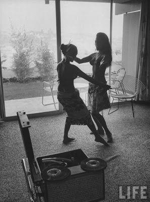 Tarita Teriipaia (Marlon Brando's 3rd wife) and friend playing records.