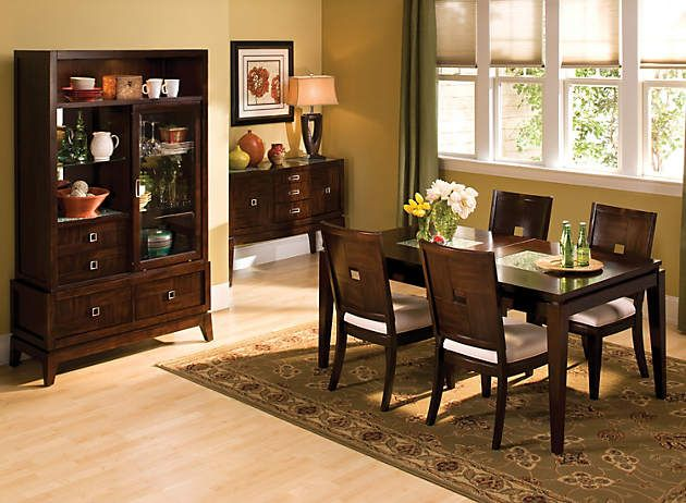 Dark wood furniture and light wood floors