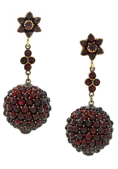 Circa 1880-1900, gilt silver and 14k gold, the dangling balls are set with fire red Bohemian garnets which smolder like embers when they catch the light. These earrings are sublime marriages, remade most probably in the 1920s from three components all late Victorian. This is vintage chic at its one-of-a-kind best. attributed Austrian
