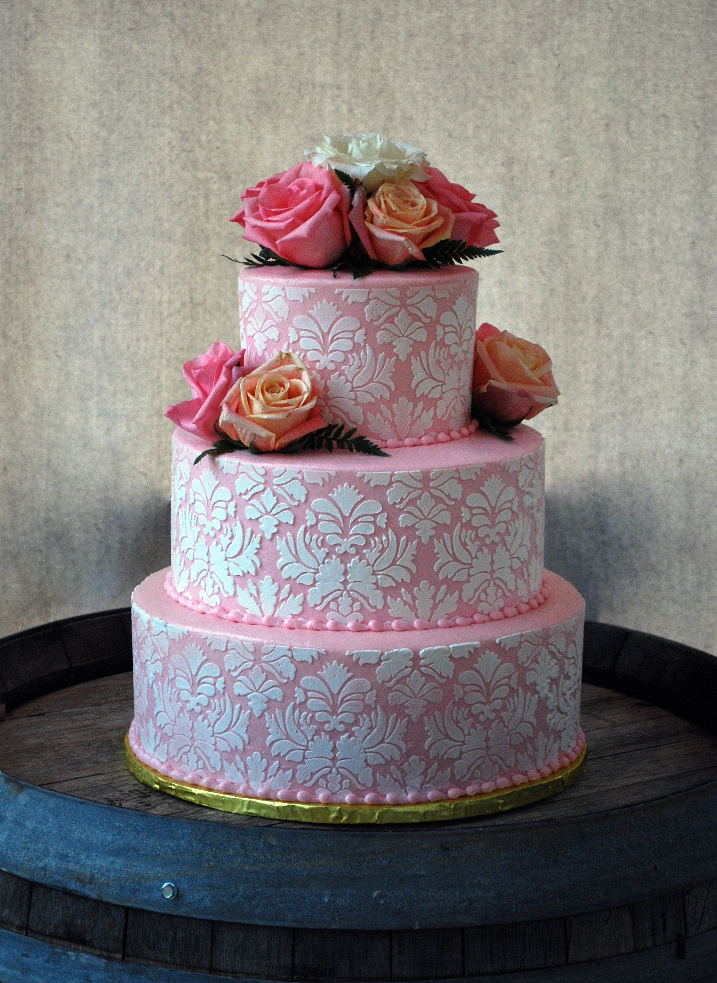 Pink And White Damask Round Wedding Cake With Roses