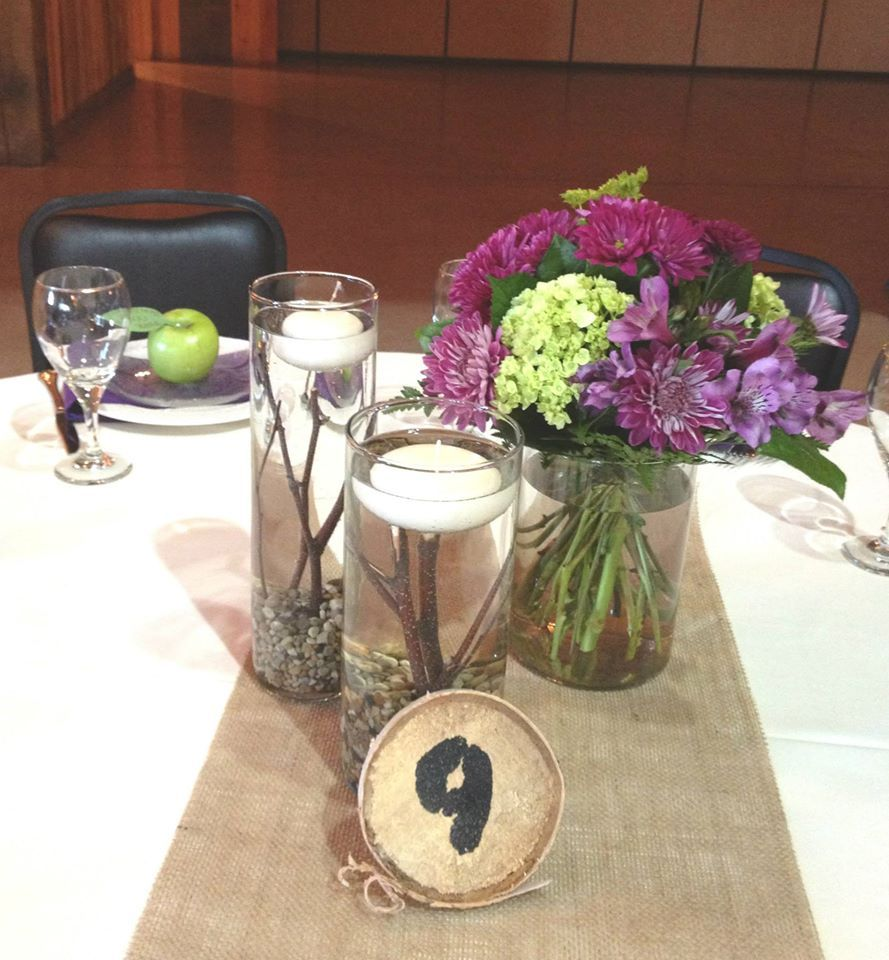 Wedding Centerpiece Using A Trio Of Glass Cylinder Vases Floating Candles Small Pebbles