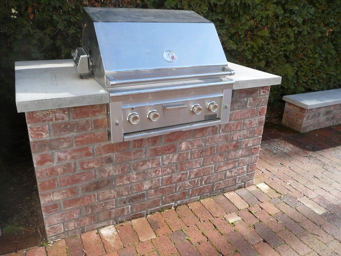 Backyard brick barbeques outdoor spaces spaces and for Build fire pit grill
