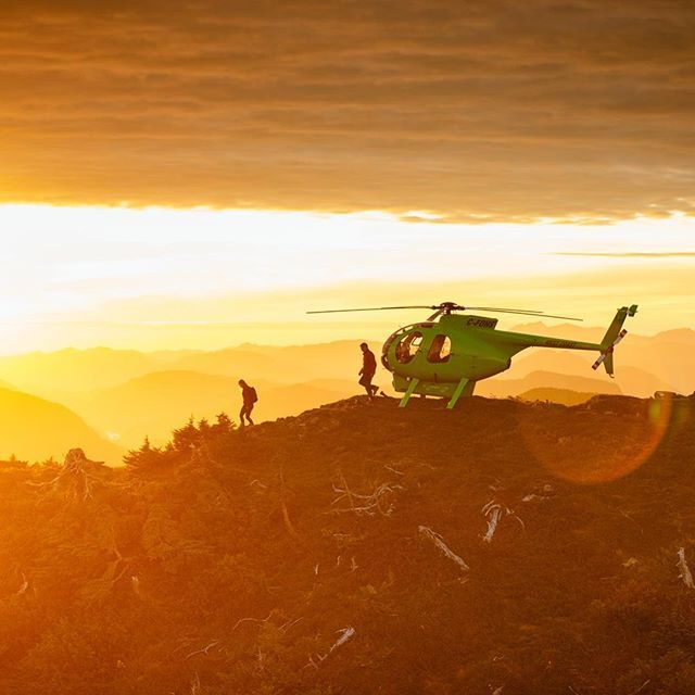 Photo by @jeremykoreski // This is golden hour overlooking the Great Bear Rainforest of British Columbia, Canada. Helicopter adventures take you to the edge, offering a new vantage point and a birds eye view that goes on forever. This helicopter landed just in time to witness a stunning sunset over the mountain range. @nimmobayresort @natgeoexpeditions