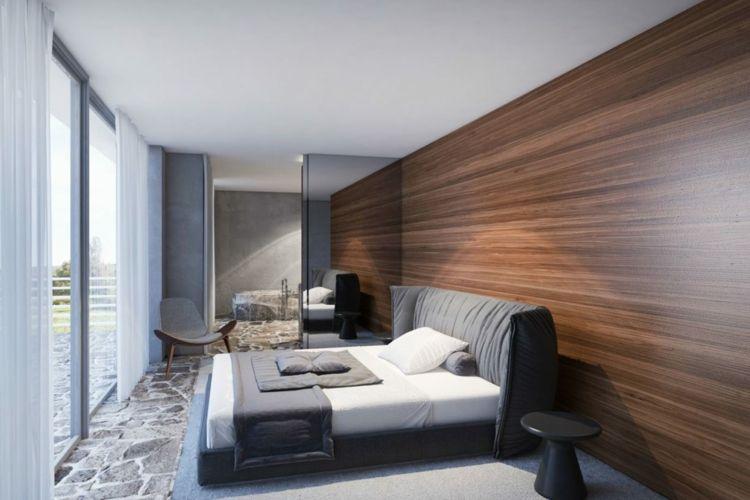 Innenarchitektur schlafzimmer ~ Schlafzimmer mit steinboden und dekorativer holzvertäfelung