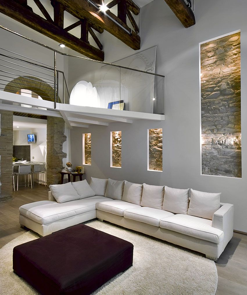 Merveilleux Living Room With Large White Sectional Couch High Ceiling Exposed Beams And  Stone Accent Wall