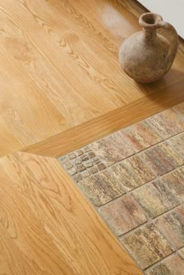 How To Mix Hardwood And Ceramic Tile Flooring In Different Rooms Ceramic Floor Tiles Entryway Flooring House Flooring
