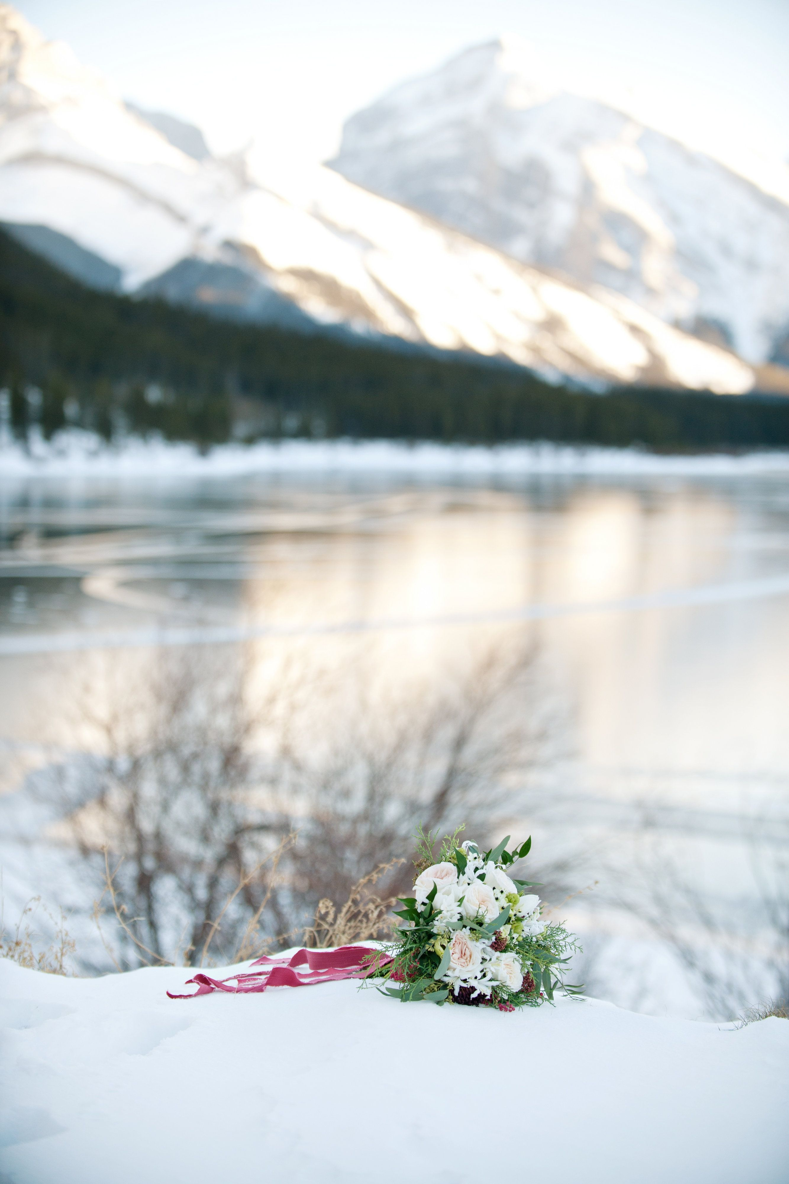Winter bridal bouquet at Spray Lakes Reservoir in Canmore