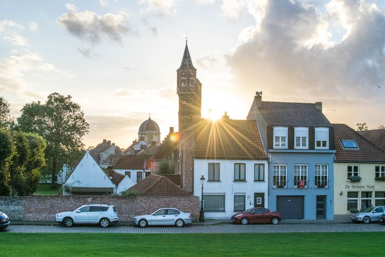 Belgium, Bruges, the English Convent (white dome in the back of the picture) and the St Sebastian's Archers Guild (tall brick building).