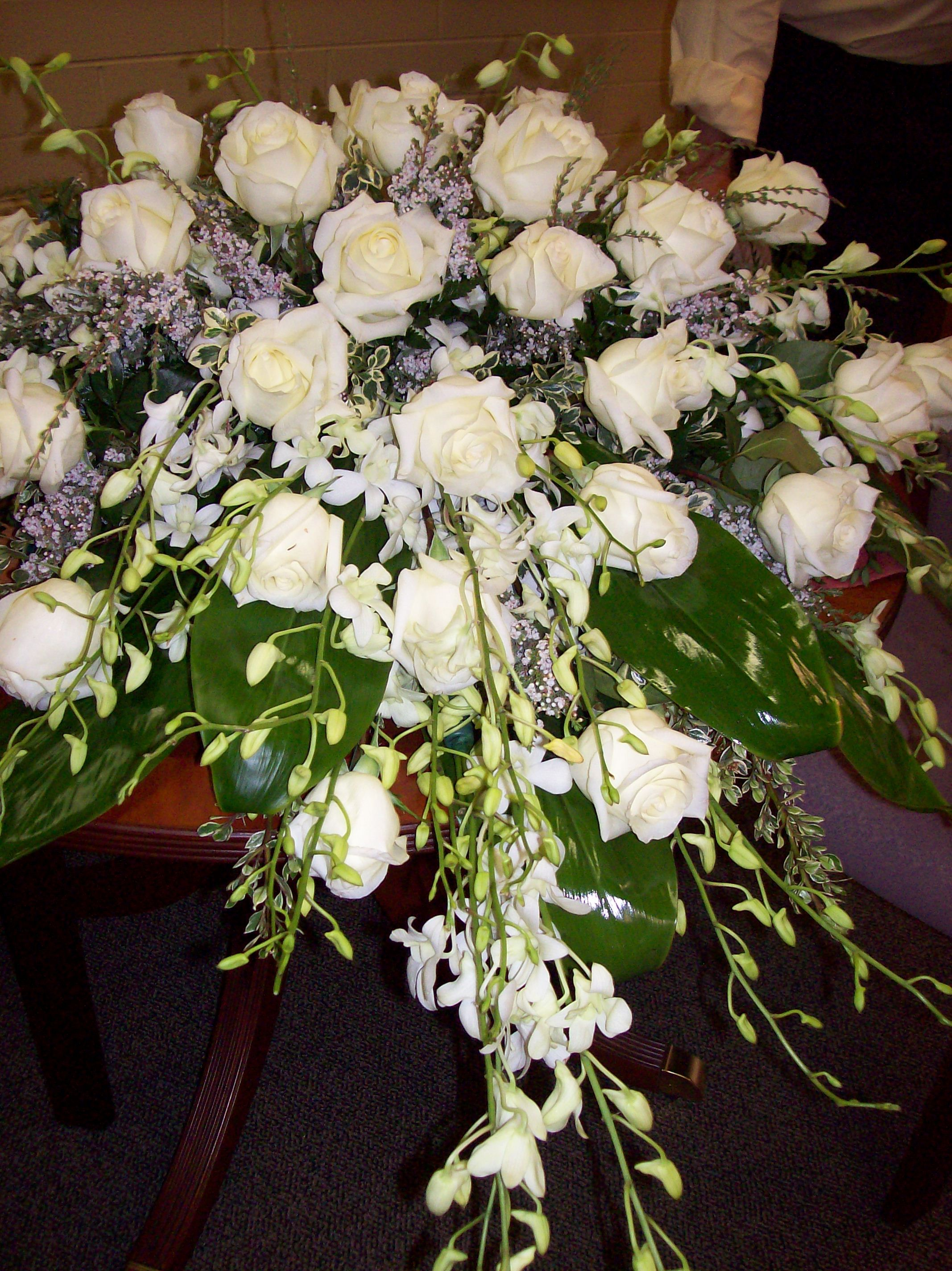 White Roses And Dendrobium Orchids Casket Cover Spray Sympathy Flowers Funeral Flowers Dendrobium Orchids