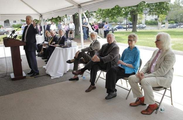 Memorial Art Gallery Director Grant Holcomb, left, introduces four artists who have new pieces in the Centennial Sculpture Park at the gallery at a ribbon cutting ceremony on Wednesday afternoon. They are, from left, Wendell Castle, Albert Paley, Jackie Ferrara and Tom Otterness.