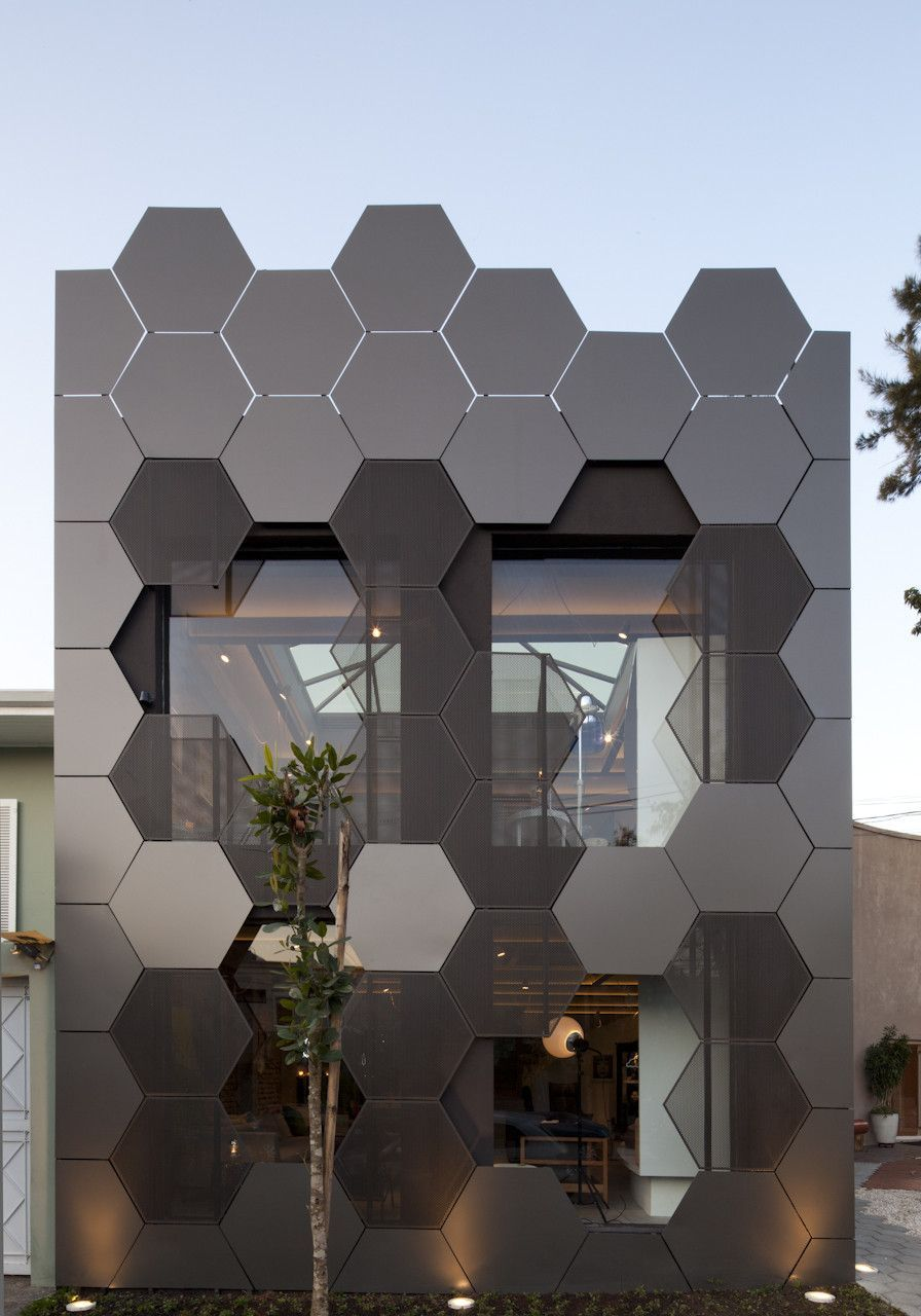 Uncategorized Black Facade perforated building facades that redefine traditional design honeycomb blackgrey steel architecture by superlimao studio read about it here