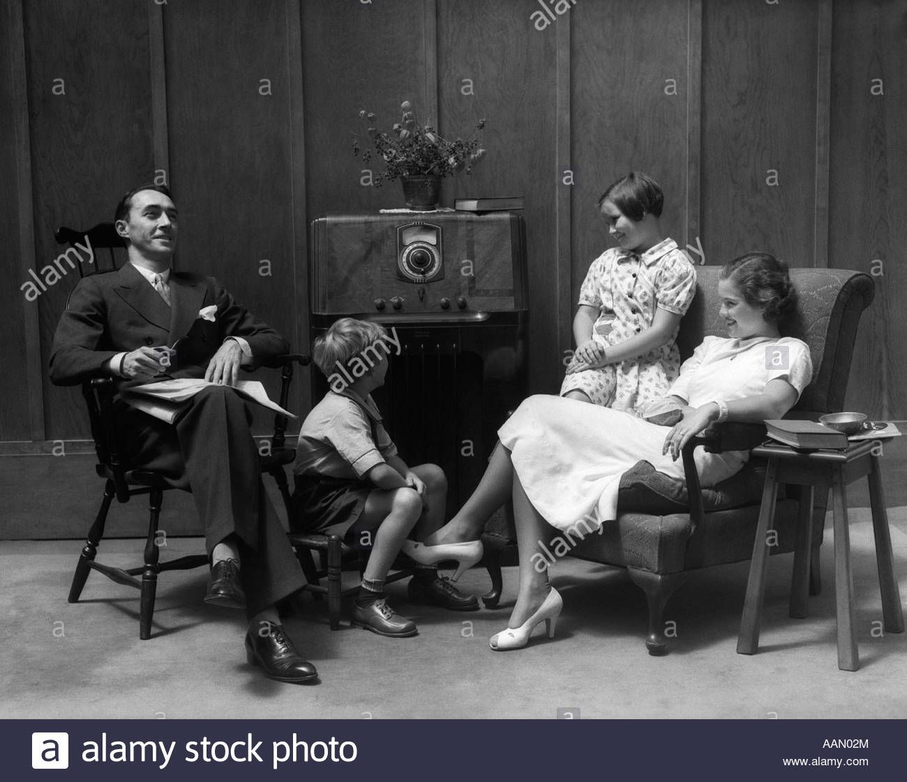 1930s 1940s Family Sitting In Living Room Listening To Radio Stock