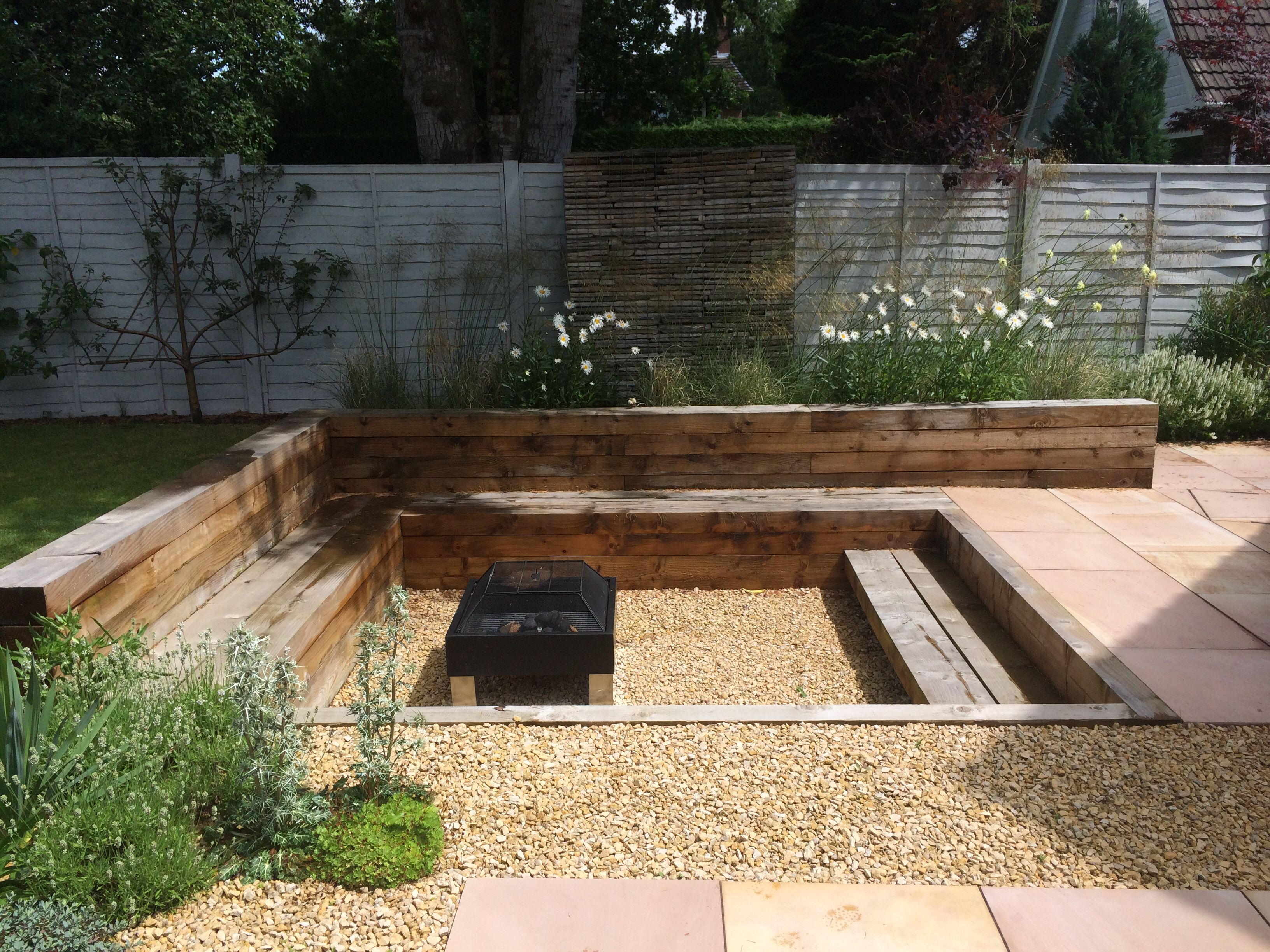 Garden i designed one year on sunken fire pit up cycled for Sunken outdoor seating