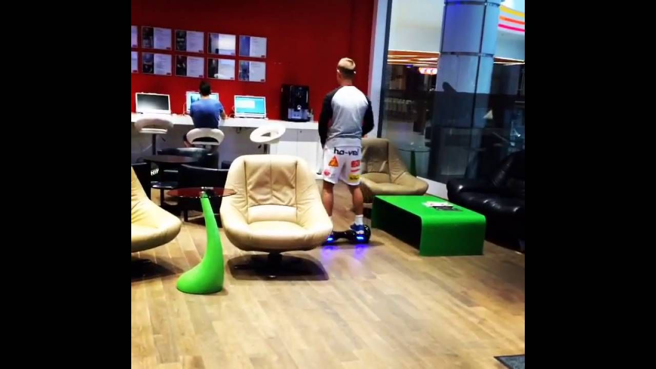 Riding hoverboard at office self balance scooter