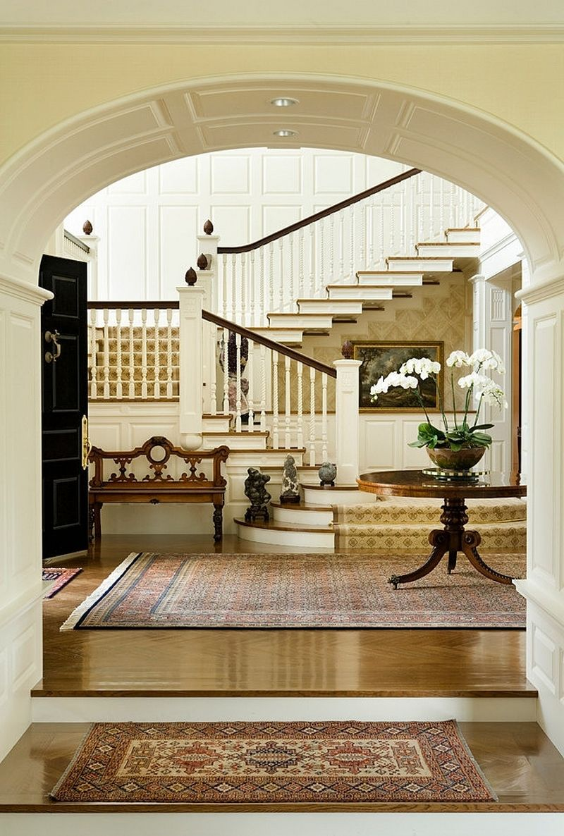 Alluring entrance hall with white arched partition wall for American classic interior